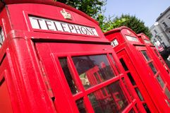 London red phone boxes. Traditional old style british red phone boxes in London Royalty Free Stock Images