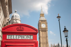 London red telephone box. Close up of a red telephone box in London with Big Ben and Houses of Parliament in the background Royalty Free Stock Photography