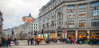 London. Regent street, Oxford circus with lots of pedestrians and cars, taxis on the road. Stock Image