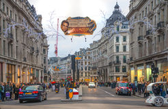 London. Regent street, Oxford circus with lots of pedestrians and cars, taxis on the road. Royalty Free Stock Photography