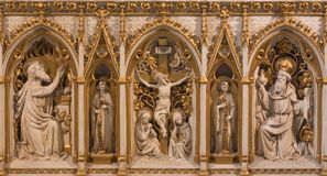 London - The releif of Crucifixion with the Melchizedek and Abraham from altar in church Immaculate Conception, Farm Street Stock Photography