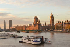 London river Thames House Parliament. Early morning view of London river Thames ,House of Parliament and Westminster Bridge with few boats on the water Stock Photos