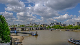 London River Thames view looking towards Hungerford railway brid. Ge. Shows vessels and Festival Pier Stock Image