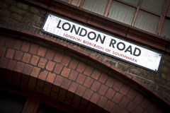London Road sign. Old dirty London Road sign in London, England Royalty Free Stock Images
