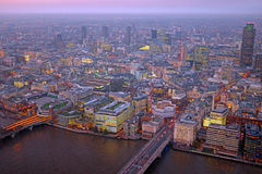 London rooftop view panorama at sunset with urban architectures. With Thames River at night Royalty Free Stock Photography