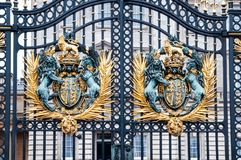 Royal Crest at Buckingham Palace Gate - famous landmark in London. Built in 1705, Palace is official Royalty Free Stock Photo