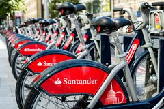 London`s Booming Bicycle Hire Business Attempting To Cut Traffic and Environment Pollution At A Cycle Hire Docking Station Stock Photo