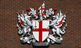 London's Coat Of Arms. In 1380 the red cross of St.George and the sword of St.Paul were adopted as the city of London's arms. The dragon supports were added Royalty Free Stock Image