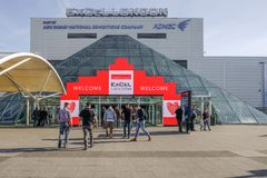 London`s Excel Exhibition Centre entrance. London, UK - February 16, 2018: towards the entrance of Excel Exhibition Centre at Royal Docks, London, with people stock images