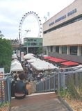 Londons eye, south bank center landmark uk famous place. Market uk famous place at noon with tourists and people shopping Stock Image