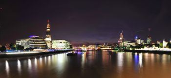 London's financial district over Thames by night