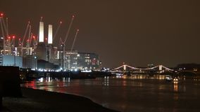 London`s night city skyline: Battersea Power Station, River Thames stock video footage