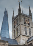 London's Shard. The Shard London pictured with Southwark Cathedral royalty free stock photo