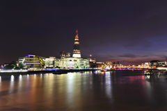 London's skyline at dusk. Beautiful panorama of London's skyline at night over the Thames river Stock Images