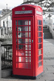 London's telephone boxes. Telephone box in London near Thames River stock photo