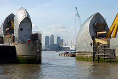 London's Thames Barrier and city of London. City of London as seen through the Thames Barrier royalty free stock photography