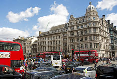 London's Traffic. Traffic including buses, coaches, taxis and cars plus members of the public and tourists crowd the streets of London, England. This shot was Stock Images