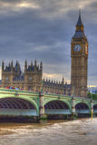 London scene. At noon, cloudy, with big ben and bus. Hdr photo Royalty Free Stock Image