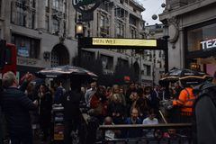 In the London. Scene of a hectic street in London where people are rushing to the Underground Royalty Free Stock Photography