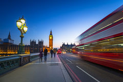 London scenery at Westminster bridge with Big Ben and blurred red bus. UK Royalty Free Stock Images