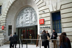 London School of Economics. London, England - March 17, 2015: People at the entrance of the London School of Economics, Old Building. Founded in 1895, the school stock images