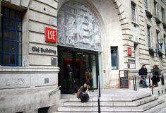 London School of Economics. London, England - March 17, 2015: People at the entrance of the London School of Economics, Old Building. Founded in 1895, the school stock photography