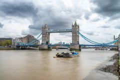 LONDON - SEPTEMBER 25, 2016: Beautiful view of Tower Bridge along Thames river. London attracts 30 million tourists annually.  stock photo