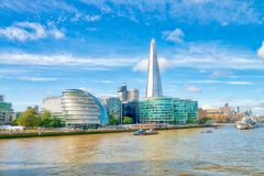 LONDON - SEPTEMBER 25, 2016: City skyline along river Thames. Lo. Ndon attracts 30 million people annually Royalty Free Stock Photos