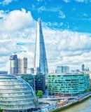 LONDON - SEPTEMBER 25, 2016: City skyline along river Thames. Lo. Ndon attracts 30 million people annually Royalty Free Stock Photography