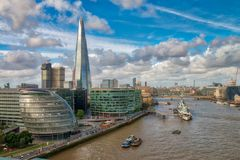 LONDON - SEPTEMBER 25, 2016: City skyline along Thames river. Lo. Ndon attracts 30 million tourists annually Royalty Free Stock Image