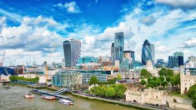 LONDON - SEPTEMBER 25, 2016: City skyline along Thames river. Lo. Ndon attracts 30 million tourists annually Stock Photography
