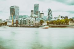 LONDON - SEPTEMBER 25, 2016: Modern city skyline along Thames ri. Ver. London attracts 30 million tourists annually royalty free stock image