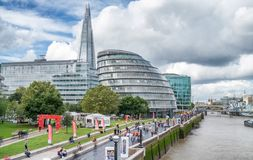 LONDON - SEPTEMBER 25, 2016: Modern city skyline along Thames ri. Ver. London attracts 30 million tourists annually stock photography