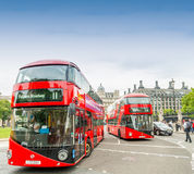 LONDON - SEPTEMBER 28, 2013: View of a London double decker bus. Along city streets. Red buses are an historic icon of London Stock Photo