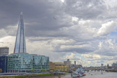 London shard and HMS Belfast. Image taken of the shard and hms belfast taken from tower bridge on a cloudy day, london, england Royalty Free Stock Photos