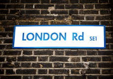 London Sign. Old dirty London Road sign in Southwick, London, England stock image