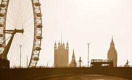London Skyline. Silhouette Skyline of the London Eye, Big Ben, Westminster and London bus. Converted to sepia Royalty Free Stock Photography