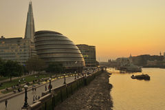 London skyline. London City Hall, the Shard and surrounding buildings along the River Thames at sunset Stock Images