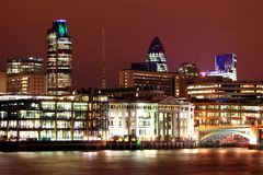 London Skyline. And river Thames at night stock image