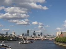 London Skyline. The City of London on a bright sunny day with white fluffy cumulus clouds and a deep blue sky stock photography