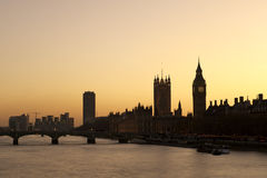 London skyline. Big Ben and the Houses of Parliament silhouetted against an orange sunset stock photography