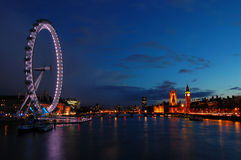 London skyline across the Thames. From the London Eye to Westminster at night Stock Images