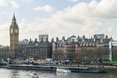 London skyline with Big Ben clock tower and river Thames. And quayside in foreground Royalty Free Stock Images