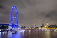 London skyline and boats on Thames river Royalty Free Stock Photography
