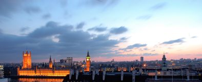 London skyline at dusk. A beautiful London skyline at dusk overlooking the Thames river and the Houses of Parliament royalty free stock photo