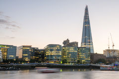 London Skyline at Dusk with City Hall. And Modern Buildings, River Thames on foreground - UK Royalty Free Stock Photography