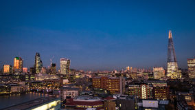 London skyline at dusk. Wide angle panoramic view of the London skyline at dusk including the City of London and River Thames left and the Shard Building right stock photos