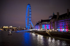 London skyline. In the evening. Iluminated London Eye and the buildings next to River Thames Royalty Free Stock Photography