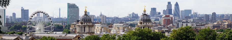 London skyline from Greenwich. With the twin domes of the Old Royal Naval College and the Greenwich Wheel in the foreground. In the distance are such landmarks royalty free stock images