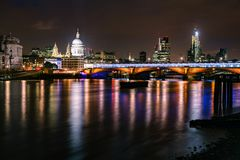 London night cityscape with Blackfriars Bridge and St Pauls Cath. London skyline with illuminated Blackfriars Bridge over the River Thames and The St Paul`s Royalty Free Stock Photos